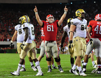 ATHENS, GA - SEPTEMBER 22: David Andrews #61 of the Georgia Bulldogs celebrates after a third quarter touchdown against the Vanderbilt Commodores at Sanford Stadium on September 22, 2012 in Athens, Georgia. (Photo by Scott Cunningham/Getty Images)