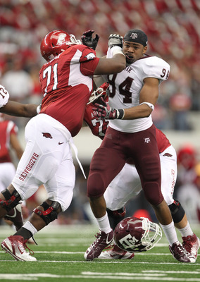 Jason Peacock, left, makes a block against Texas A&M last year.