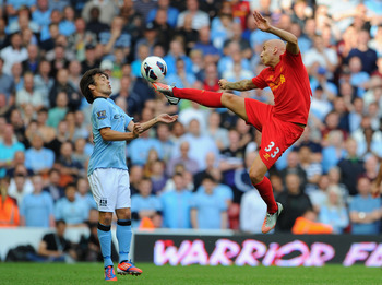 LIVERPOOL, ENGLAND - AUGUST 26:  Jonjo Shelvey of Liverpool competes with David Silva of Manchester City during the Barclays Premier League match between Liverpool and Manchester City at Anfield on August 26, 2012 in Liverpool, England. (Photo by Michael
