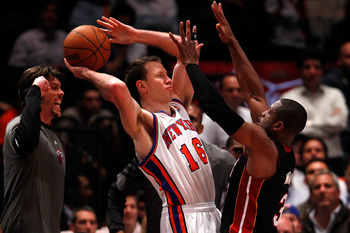 Steve Novak being suffocated by Dwayne Wade