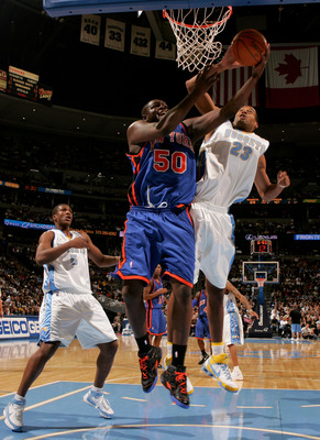 Marcus Camby blocking Zach Randolph