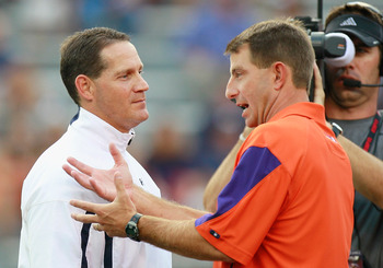 Auburn head coach Gene Chizik (left) with Clemson head coach Dabo Swinney