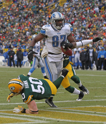 Detroit Lions tight end Brandon Pettigrew hits pay dirt against the Green Bay Packers.