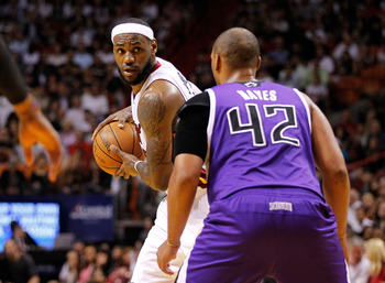 MIAMI, FL - FEBRUARY 21:  LeBron James #6 of the Miami Heat is guarded by Chuck Hayes #42 of the Sacramento Kings during a game at American Airlines Arena on February 21, 2012 in Miami, Florida. NOTE TO USER: User expressly acknowledges and agrees that, b