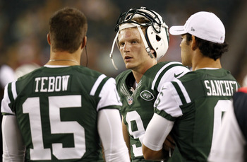New York Jets' quarterbacks Mark Sanchez and Tim Tebow.