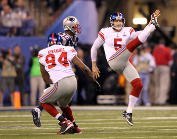 INDIANAPOLIS, IN - FEBRUARY 05:  Steve Weatherford #5 of the New York Giants kicks the ball against the New England Patriots during Super Bowl XLVI at Lucas Oil Stadium on February 5, 2012 in Indianapolis, Indiana.  (Photo by Jamie Squire/Getty Images)