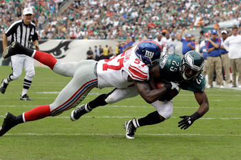 PHILADELPHIA, PA - SEPTEMBER 25:  LeSean McCoy #25 of the Philadelphia Eagles is tackled by  Jacquian Williams #57 of the New York Giants during the game at Lincoln Financial Field on September 25, 2011 in Philadelphia, Pennsylvania.  (Photo by Rob Carr/G