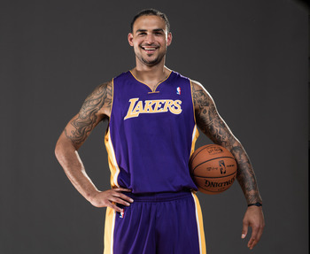 Robert Sacre, the 2012 NBA draft's Mr. Irrelevant, took his rookie photos without the number 12 following the Dwight Howard trade.