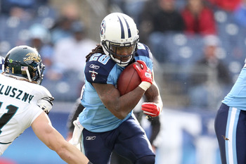 Titans star Chris Johnson bursting through the hole