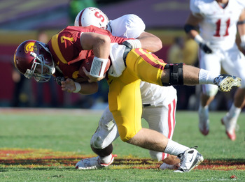 LOS ANGELES, CA - NOVEMBER 14:  Matt Barkley #7 of the USC Trojans is sacked by Will Powers #42 of the Stanford Cardinal during the second half at the Los Angeles Memorial Coliseum on November 14, 2009 in Los Angeles, California.  Stanford won 55-21.   (P