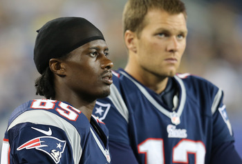 Expect Brandon Lloyd and Tom Brady to turn those frowns upside down once the games start counting on September 9.