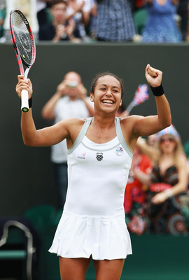LONDON, ENGLAND - JUNE 27:  Heather Watson of Great Britain celebrates match point during her Ladies' singles second round match against Jamie Lee Hampton of USA on day three of the Wimbledon Lawn Tennis Championships at the All England Lawn Tennis and Cr