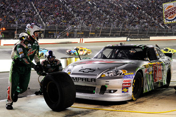 BRISTOL, TN - AUGUST 25:  Dale Earnhardt Jr., driver of the #88 Diet Mountain Dew/National Guard Chevrolet, pits during the NASCAR Sprint Cup Series IRWIN Tools Night Race at Bristol Motor Speedway on August 25, 2012 in Bristol, Tennessee.  (Photo by John