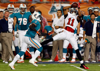 Underwood (right) catches a pass in the preseason against Miami.