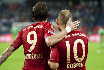 Arjen Robben and Mario Mandzukic celebrate
