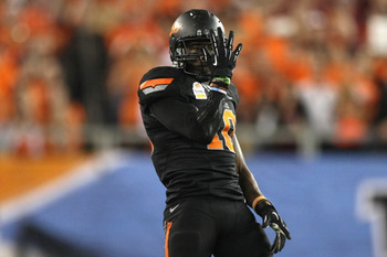 GLENDALE, AZ - JANUARY 02:  Markelle Martin #10 of the Oklahoma State Cowboys gestures against the Stanford Cardinal during the Tostitos Fiesta Bowl on January 2, 2012 at University of Phoenix Stadium in Glendale, Arizona.  (Photo by Donald Miralle/Getty