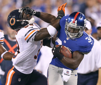 N.Y. Giants RB David Wilson showing his strength in the Aug. 24 preseason game against Chicago.