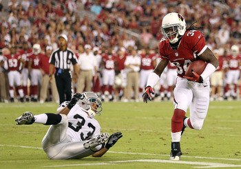 Arizona Cardinal RB Ryan Williams shaking off a defender in the Aug. 17 preseason game in Arizona.