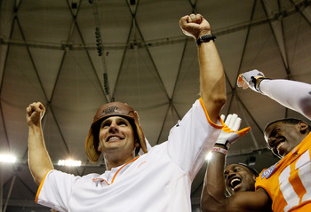 ATLANTA, GA - AUGUST 31:  Head coach Derek Dooley of the Tennessee Volunteers celebrates with the leather helmet after their 35-21 over the North Carolina State Wolfpack at Georgia Dome on August 31, 2012 in Atlanta, Georgia.  (Photo by Kevin C. Cox/Getty