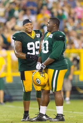 Jerel Worthy and B.J. Raji