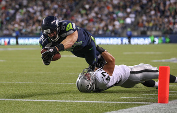 SEATTLE, WA - AUGUST 30:  Cooper Helfet #84 of the Seattle Seahawks scores a touchdown against Chad Kilgore #47 of the Oakland Raiders at CenturyLink Field on August 30, 2012 in Seattle, Washington.  (Photo by Otto Greule Jr/Getty Images)