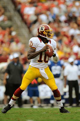LANDOVER, MD - AUGUST 25:  Robert Griffin III #10 of the Washington Redskins drops back to throw a pass against the Indianapolis Colts during a preseason game at FedExField on August 25, 2012 in Landover, Maryland.  (Photo by Patrick McDermott/Getty Image