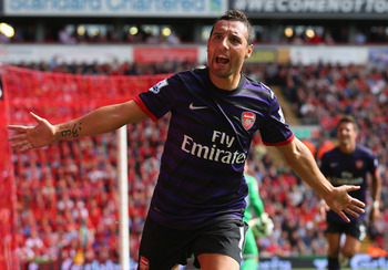 LIVERPOOL, ENGLAND - SEPTEMBER 02:  Santi Cazorla of Arsenal celebrates after scoring the second goal during the Barclays Premier League match between Liverpool and  Arsenal at Anfield on September 2, 2012 in Liverpool, England.  (Photo by Alex Livesey/Ge