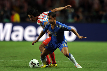 MONACO - AUGUST 31:  Eden Hazard of Chelsea in action with Arda Turan of Atletico Madrid during the UEFA Super Cup match between Chelsea and Atletico Madrid at Louis II Stadium on August 31, 2012 in Monaco, Monaco.  (Photo by Chris Brunskill/Getty Images)