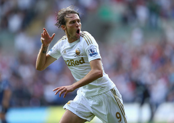 SWANSEA, WALES - AUGUST 25:  Michu of Swansea celebrates scoring the second goal during the Barclays Premier League match between Swansea City and West Ham United at the Liberty Stadium on August 25, 2012 in Swansea, Wales.  (Photo by Richard Heathcote/Ge
