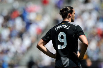 BALTIMORE, MD - JULY 28: Andrew Carroll #9 of Liverpool waits for play to resume against the Tottenham Hotspur during a pre-season tour friendly match at M&T Bank Stadium on July 28, 2012 in Baltimore, Maryland. The match ended in a, 0-0, draw. (Photo by