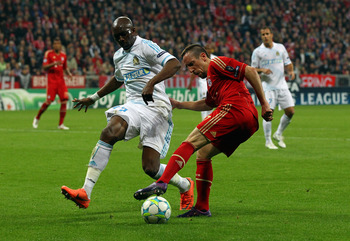 MUNICH, GERMANY - APRIL 03: Franck Ribery (R) of Muenchen and Stephane Mbia (L) of Marseille battle for the ball during the UEFA Champions League quarter-final second leg match at Allianz Arena on April 3, 2012 in Munich, Germany.  (Photo by Martin Rose/B