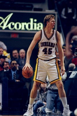 Center Rik Smits of the Indiana Pacers looks on during a game against the Golden State Warriors at the Market Square Arena in Indianapolis, Indiana. The Pacers won the game, 96-83.