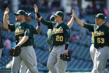 The A's high five after a win on August 30