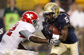 September 1, 2012; Pittsburgh, PA, USA; Pittsburgh Panthers wide receiver Cameron Saddler (5) carries the ball on a kick-off return against Youngstown State Penguins linebacker Dubem Nwadiogbu (22) during the second quarter at Heinz Field. Mandatory Credi