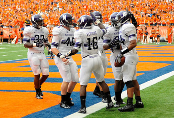 Sep 1, 2012; Syracuse, NY, USA; Northwestern Wildcats linebacker Chi Chi Ariguzo (right) celebrates a third quarter touchdown against the Syracuse Orange at the Carrier Dome. Mandatory Credit: Rich Barnes-US PRESSWIRE