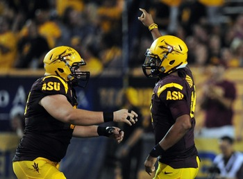 Aug. 30, 2012; Tempe, AZ, USA; Arizona State quarterback Michael Eubank (18) celebrates after scoring a touchdown in the second quarter against Northern Arizona at Sun Devil Stadium. Mandatory Credit: Jennifer Hilderbrand-US PRESSWIRE