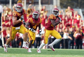 September 1, 2012; Ames, IA, USA;  Iowa State Cyclones wide receiver Tobais Palmer (4) runs after making a catch against the Tulsa Golden Hurricanes in the first quarter at Jack Trice Stadium. Iowa State 38 Tulsa 23. Mandatory Credit: Reese Strickland-US 
