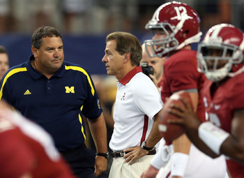 Michigan coach Brady Hoke (left) stares down the Tide during Saturday's duel at Cowboys Stadium.