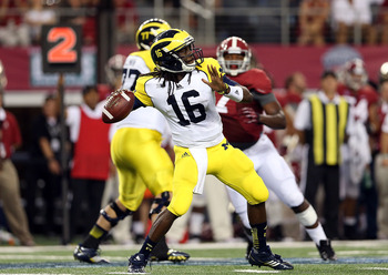 Michigan quarterback Denard Robinson was 11-of-26 (200 yards, 2 INT, 1 TD) in a 41-14 loss Saturday to Alabama.