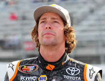 Travis Pastrana may be looking up in this photo, but his NASCAR career is still stuck at the starting line.
