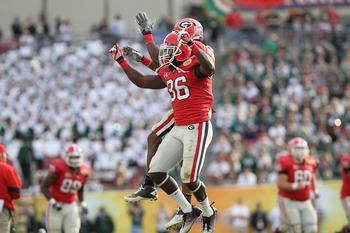 January 2, 2012; Tampa, FL, USA; Georgia Bulldogs safety Shawn Williams (36) is congratulated by cornerback Brandon Boykin (2) after he intercepted the ball during the second half of the 2012 Outback Bowl against the Michigan State Spartans at Raymond Jam