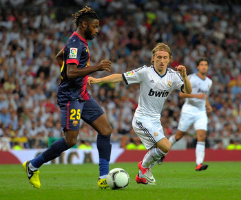 New recruits Alex Song and Luka Modric fight over ball