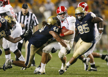 September 1, 2012; Pittsburgh, PA, USA; Pittsburgh Panthers linebacker Shane Gordon (44) sacks Youngstown State Penguins quarterback Kurt Hess (12) during the third quarter at Heinz Field. the Youngstown State Penguins won 31-17. Mandatory Credit: Charles
