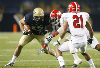 September 1, 2012; Pittsburgh, PA, USA; Pittsburgh Panthers fullback Mark Giubilato (43) carries the ball against Youngstown State Penguins safety Jeremey Edwards (rear) and cornerback Dale Peterman (21) during the third quarter at Heinz Field. The Youngs