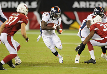 GLENDALE, AZ - AUGUST 30:  Ronnie Hillman #34 of the Denver Broncos runs the ball through the Arizona Cardinals defensive line at University of Phoenix Stadium on August 30, 2012 in Glendale, Arizona.  (Photo by Norm Hall/Getty Images)