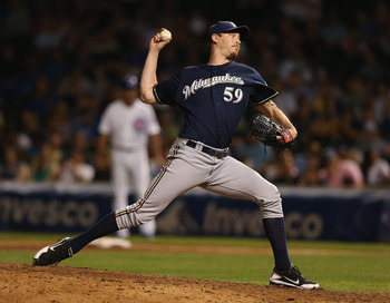 Brewers closer John Axford has been just part of a bullpen that has been anything but reliable.