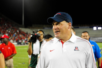 Sept. 1, 2012; Tucson, AZ, USA; Arizona Wildcats head coach Rich Rodriguez reacts after beating the Toledo Rockets 24-17 in overtime at Arizona Stadium. Mandatory Credit: Matt Kartozian-US PRESSWIRE