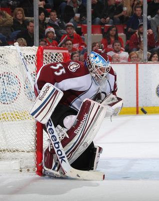 DETROIT, MI - FEBRUARY 25:  Jean-Sebastien Giguere #35 of the Colorado Avalanche makes a save against the Detroit Red Wings during their NHL game at Joe Louis Arena on February, 2012 in Detroit, Michigan.  (Photo by Dave Sandford/Getty Images)