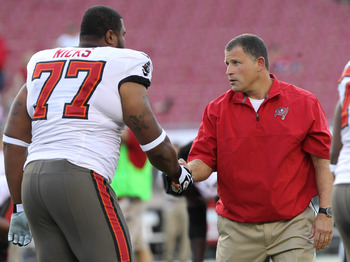 August 24, 2011; Tampa, FL, USA;  Tampa Bay Buccaneers head coach Greg Schiano with offensive guard Carl Nicks (77) prior to the game against the New England Patriots at Raymond James Stadium. Mandatory Credit: Kim Klement-US PRESSWIRE