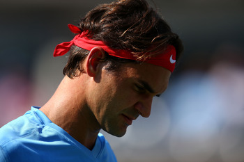 Roger Federer advances to the quarterfinals by way of a walkover against Mardy Fish